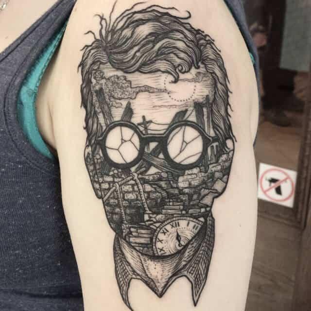 surrealism tattoo on arm