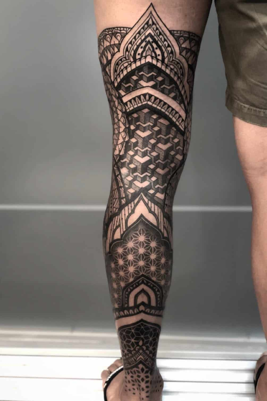 pointillism leg tattoo