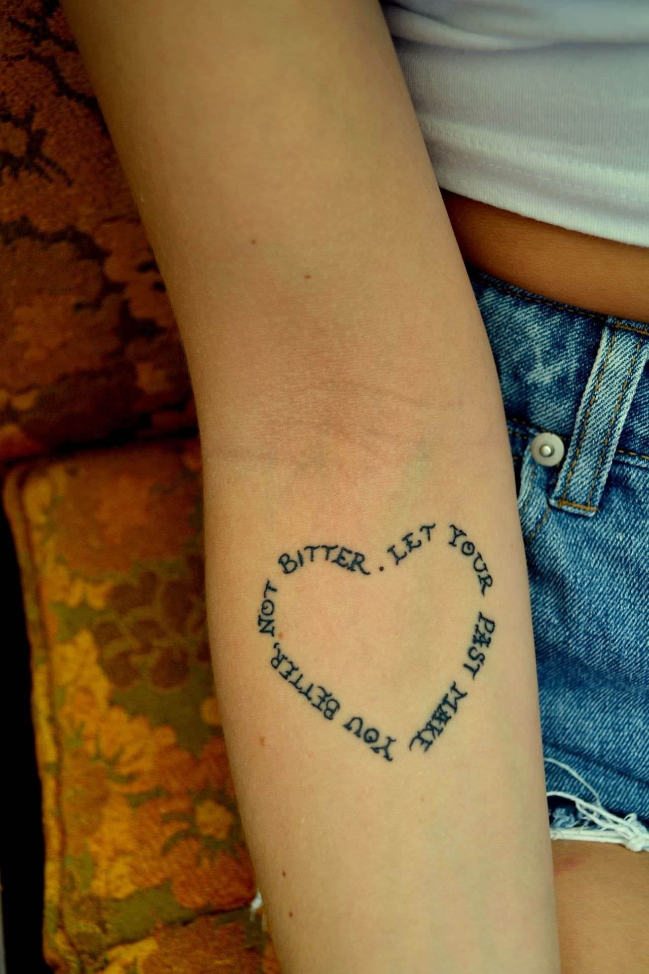 Heart-Shaped Quote Tattoo