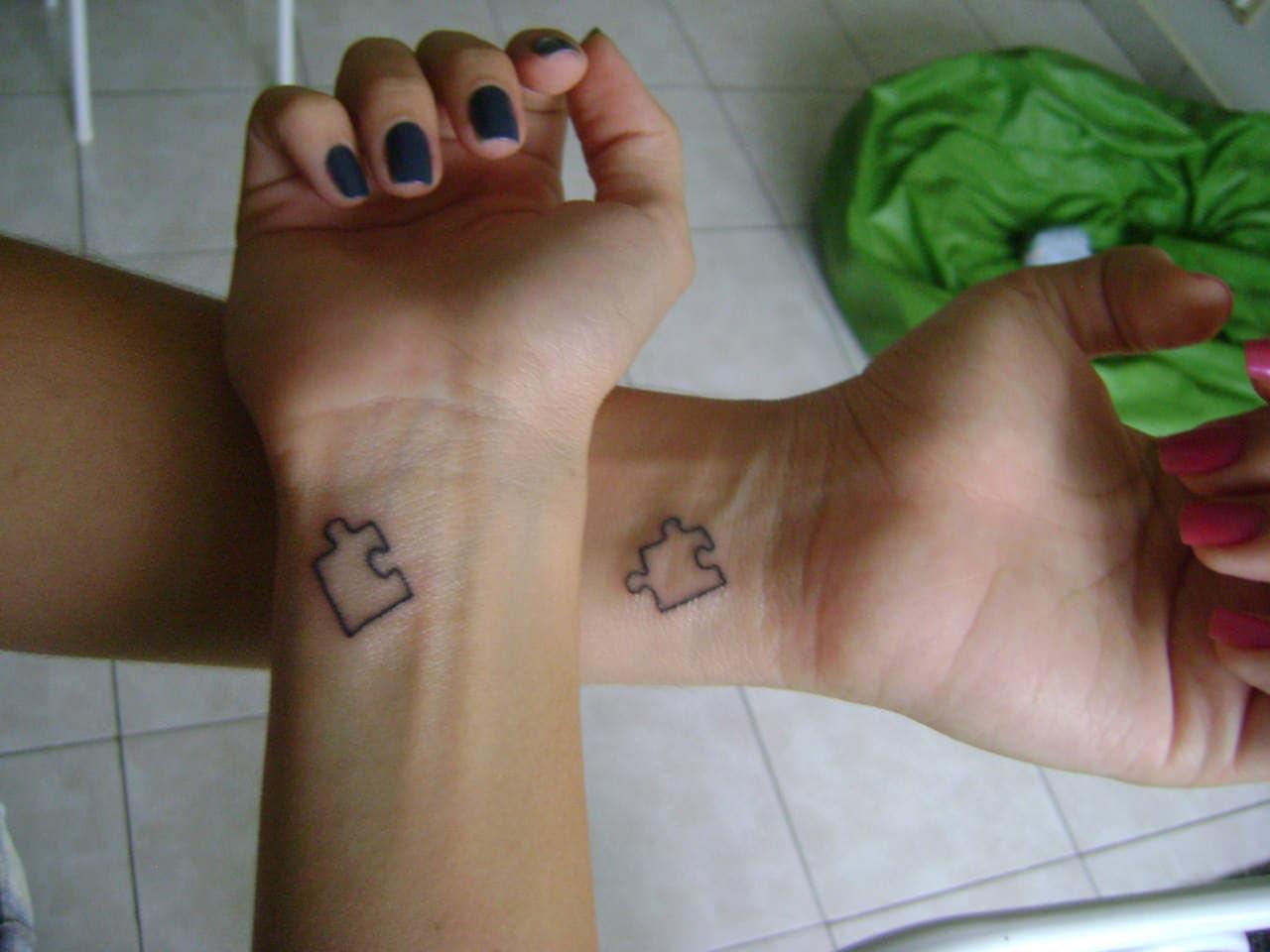 Jigsaw puzzle tattoos couple