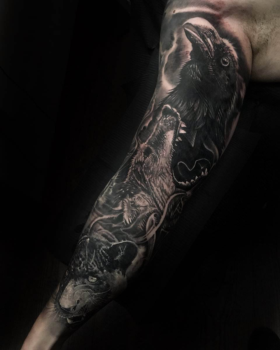 raven and wolf sleeve tattoo