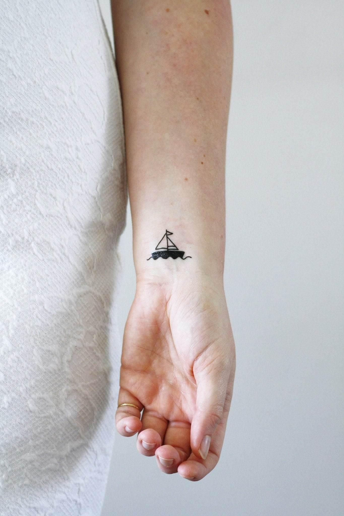 tiny boat tattoos