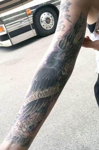 Ash Costellos tattoos – black crow right arm sleeve