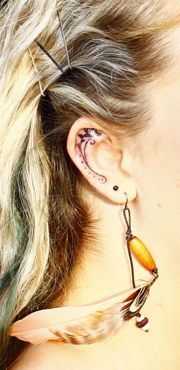 Pretty Inner Ear Tattoo