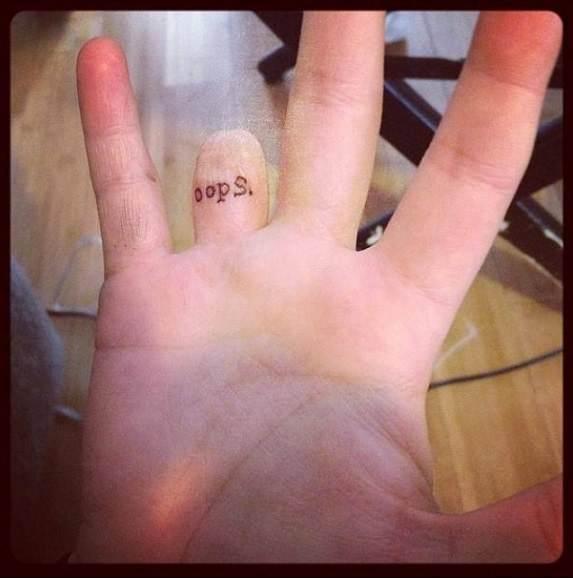 Interesting Tattoo On Finger