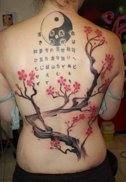 Tattoos Designs for Women: Cherry blossoms tattoo on back