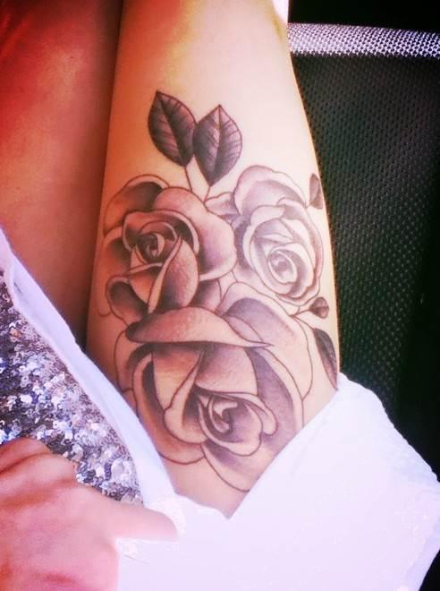 Rose tattoos on thigh